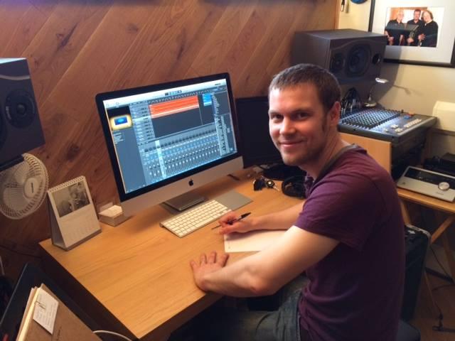 Adam Bulley at desk